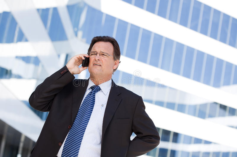 Download Concerned Businessman Talks On His Cell Phone Stock Image - Image: 13503337