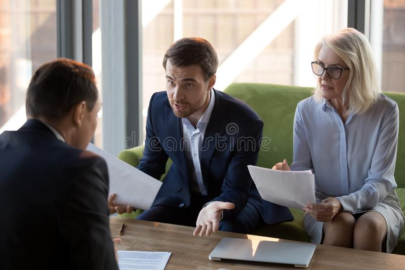 Mad businessman dispute with business partner over agreement royalty free stock image