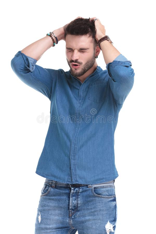 Free Concerned Casual Holding Both Hands On His Head And Praying Stock Photography - 161648072