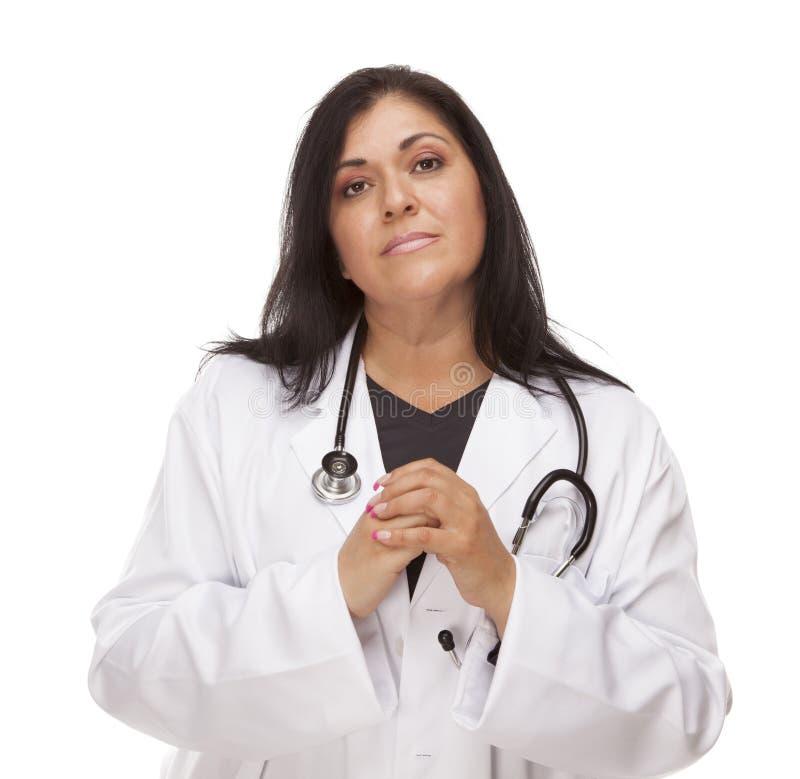 Concerned Female Hispanic Doctor or Nurse stock photography