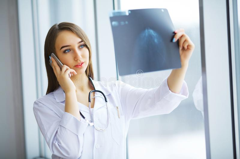 Concerned male doctor looking at x-ray.  stock image