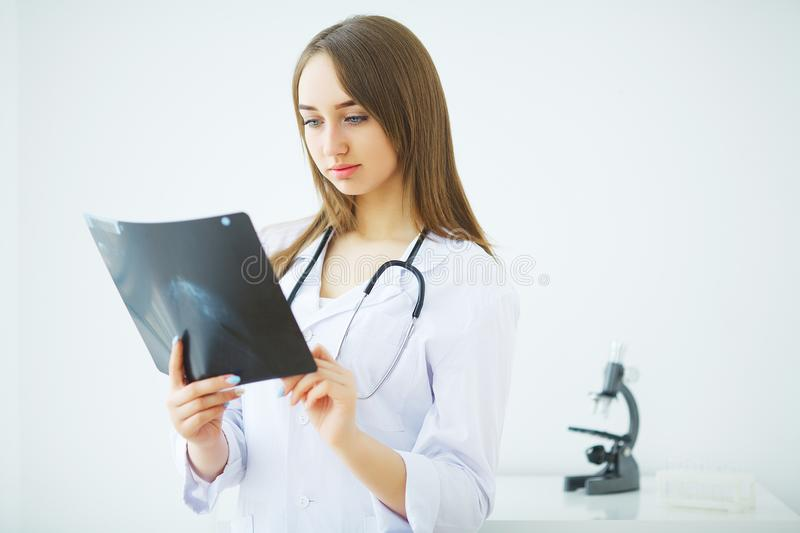 Concerned male doctor looking at x-ray.  stock images