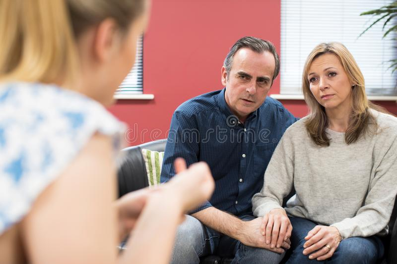 Concerned Mature Couple Talking With Female Counselor. Concerned Mature Couple Talk With Female Counselor stock photography