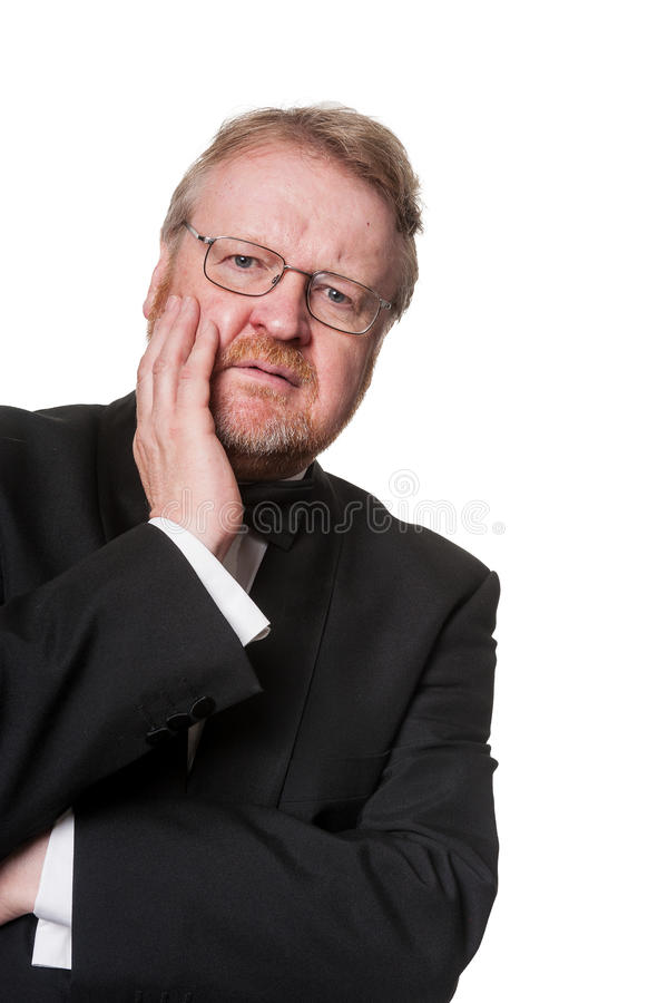 Concerned middle aged man in tuxedo on white stock images