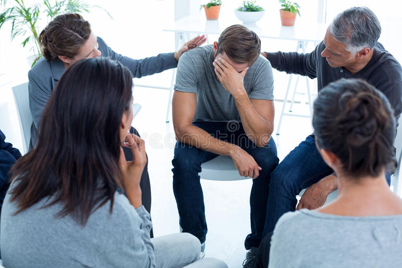 Download Concerned Patients Comforting Another In Rehab Group Stock Photo - Image of adult, counselor: 54776370