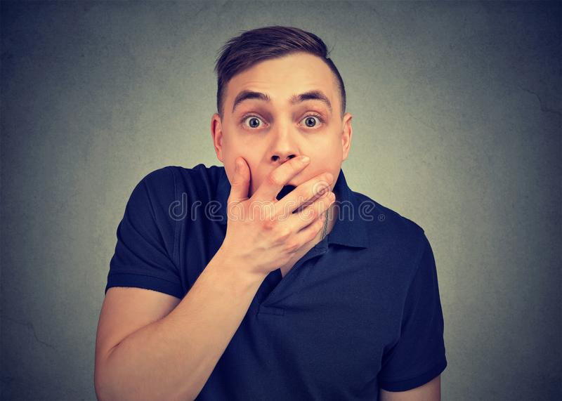 Concerned scared shocked young man royalty free stock photo