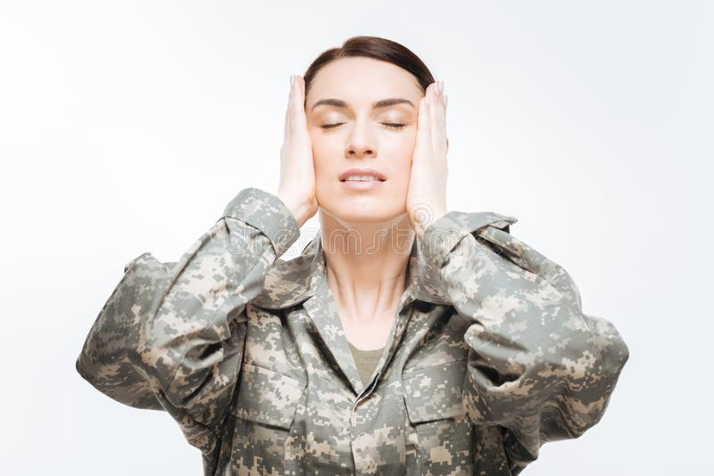 Concerned serious woman worrying about homeland royalty free stock image