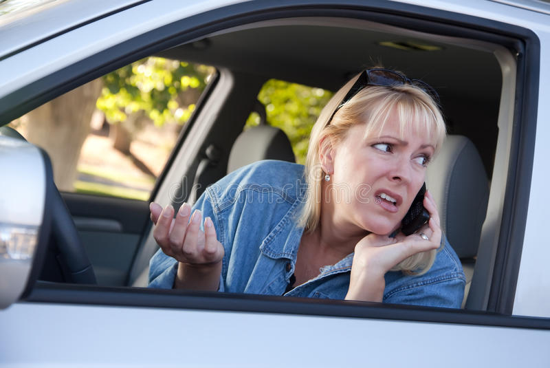 Download Concerned Woman Using Cell Phone While Driving Stock Photo - Image: 11067608