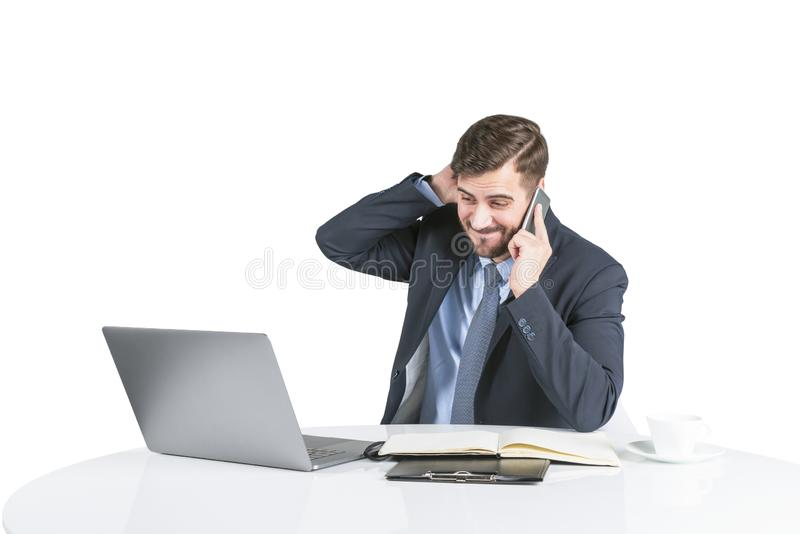 Concerned young man in suit on phone at table royalty free stock photo