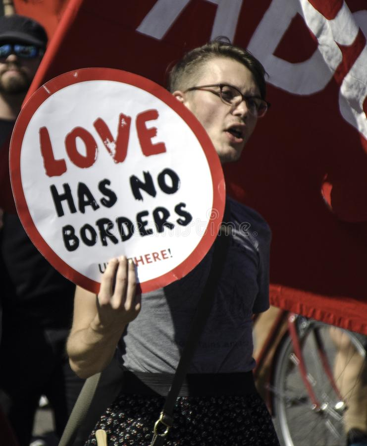 Protesters in Denver Colorado Carry Signs Critical of ICE, Immigration Police and an Immigration Detention Facility. Concerns about treatment of detainees fuel royalty free stock images