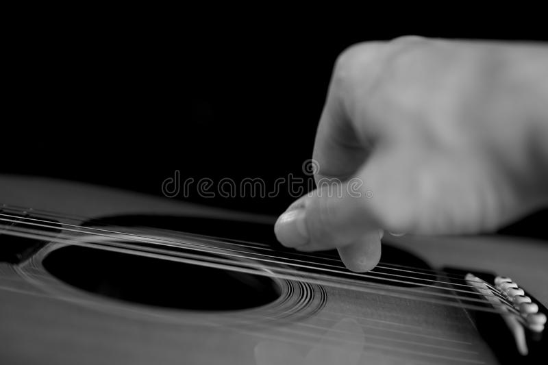 Concert acoustic guitarist. Acoustic guitar being played right hand stock images
