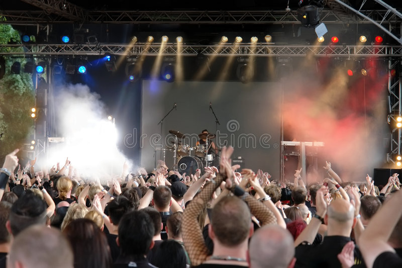 Concert Crowd. Cheering crowd at concert, musicians on the stage stock images