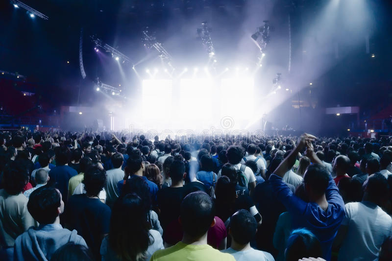 Concert crowd of people in front of bright stage lights royalty free stock image