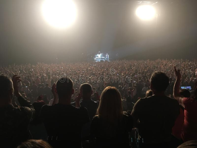Concert crowd. Standing ovation by fans at the end stock photos