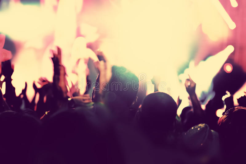 Concert, disco party. People with hands up in night club. stock photos