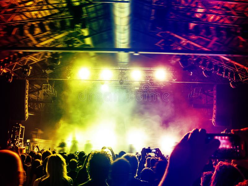 Colourful stage with dancing fans stock photos