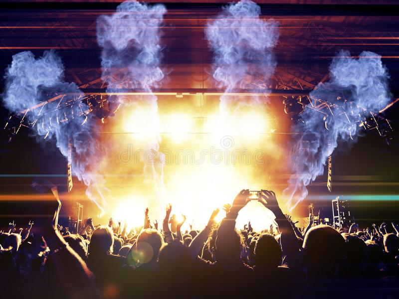 Concert crowd in front of stage lights royalty free stock photography