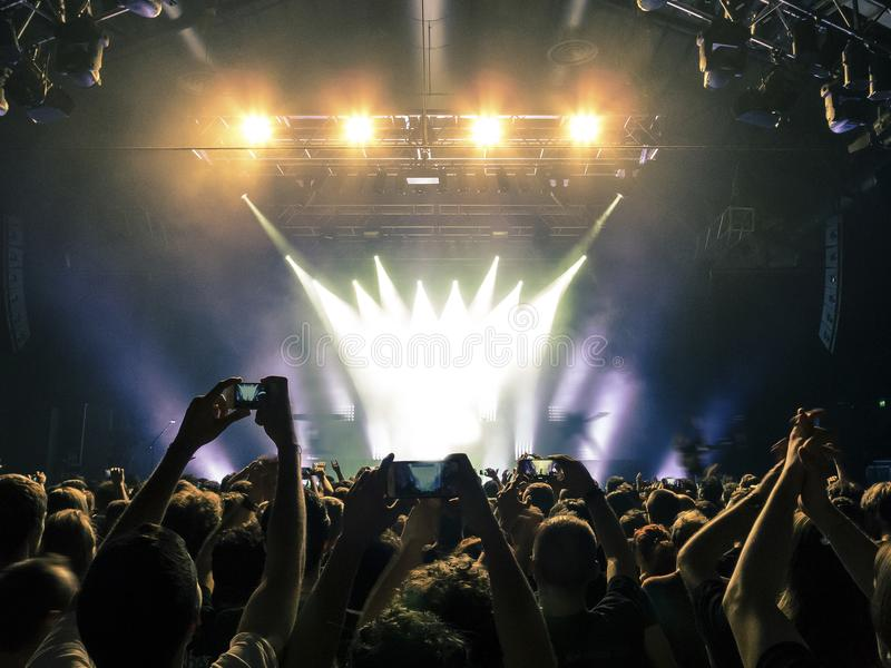Concert crowd in front of stage lights stock images