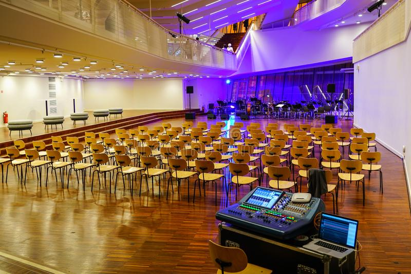 Concert hall before concert, empty chairs, musical instruments and sound board. Waiting for the audience stock photos