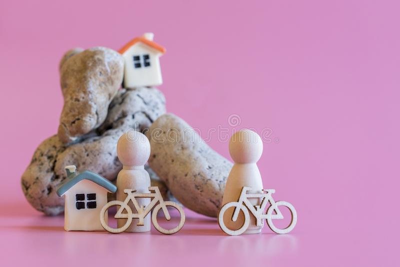 concert of a healthy lifestyle people with bicycles. wooden figurines of people with bicycles on the background of a stone mountai royalty free stock photography