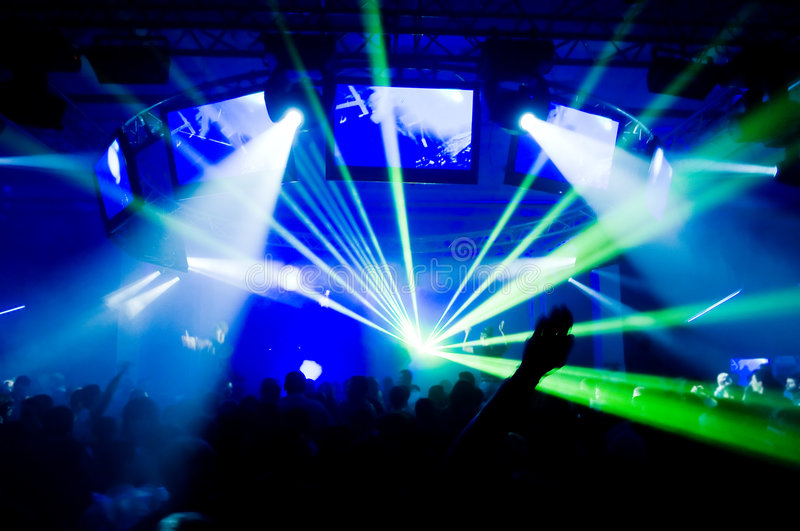 Concert, laser show. Blurred motion royalty free stock photo