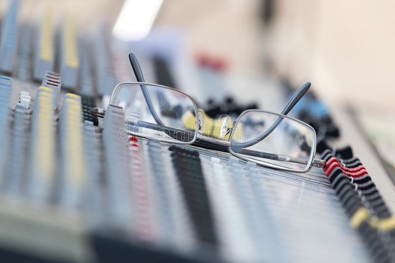 Concert music console with sunglasses stock photography