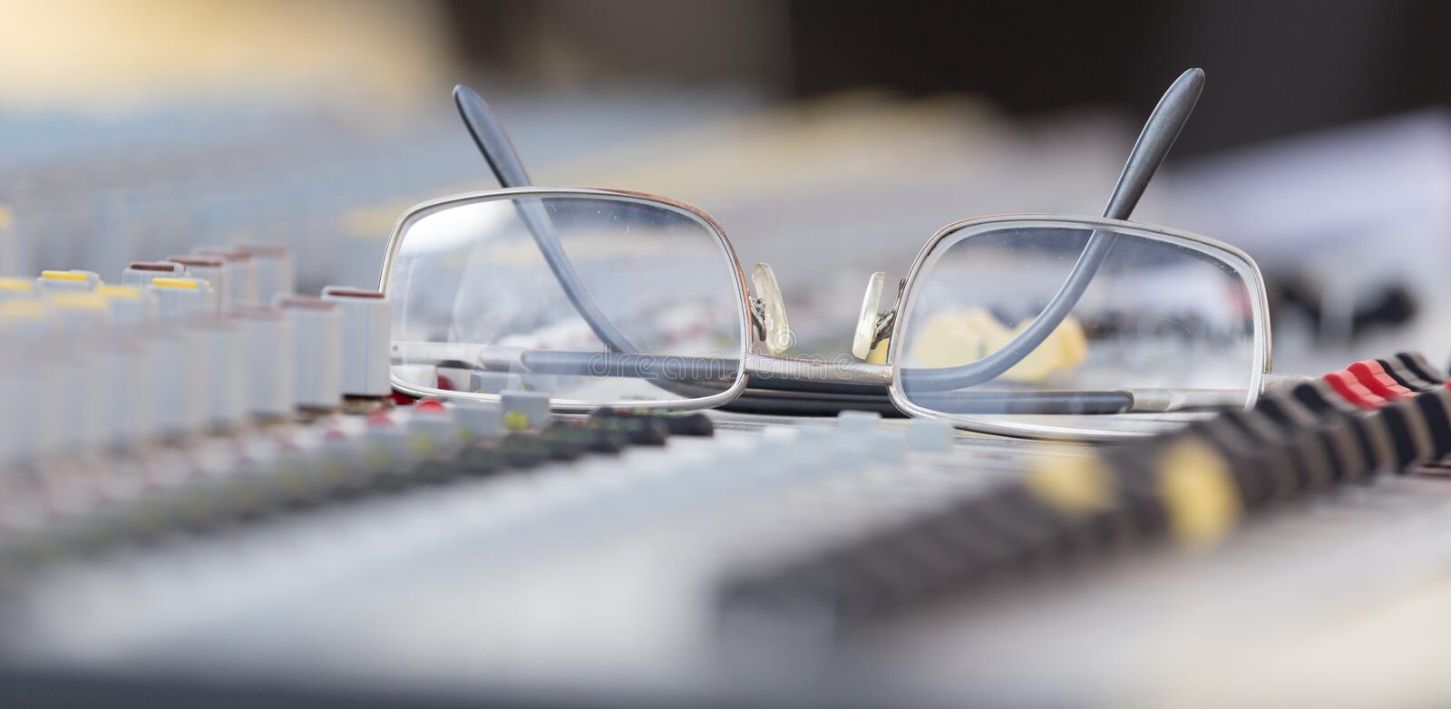 Concert music console with sunglasses stock photos