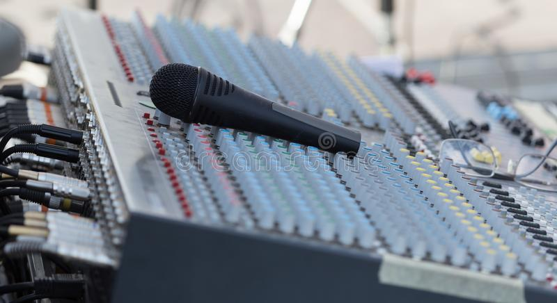 Concert music control with microphone royalty free stock photo