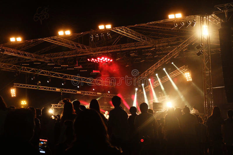 Concert Stage. Crowd and big stage in outdoor Concert, effect lighting from stage rigging truss ,music festival,Thailand royalty free stock image