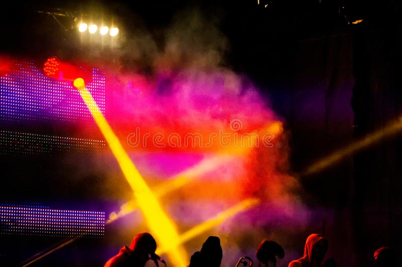 Concert stage lighting and artists. Evening rest at a music concert. Web banner stock photography