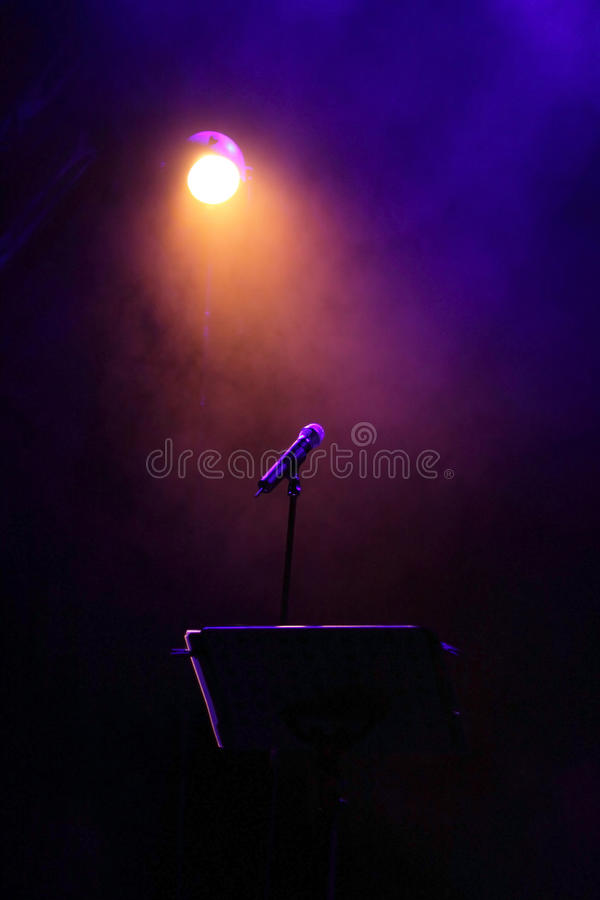 Concert stage with mic. Colorful concert stage with mic stock image