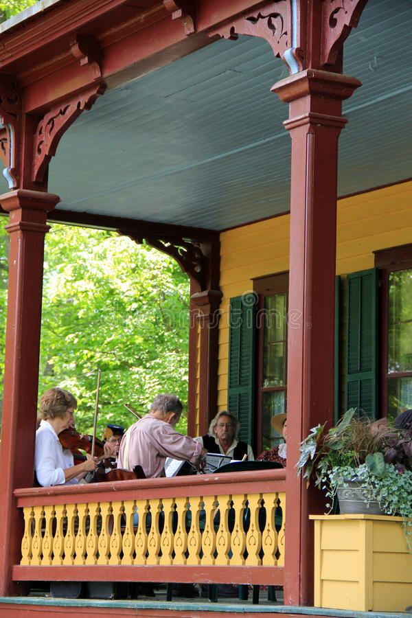Concert for visitors on porch of Grant Cottage, Sa. Musicians dressed in period garments, performing a concert on porch of historic Grant Cottage for visitors royalty free stock images