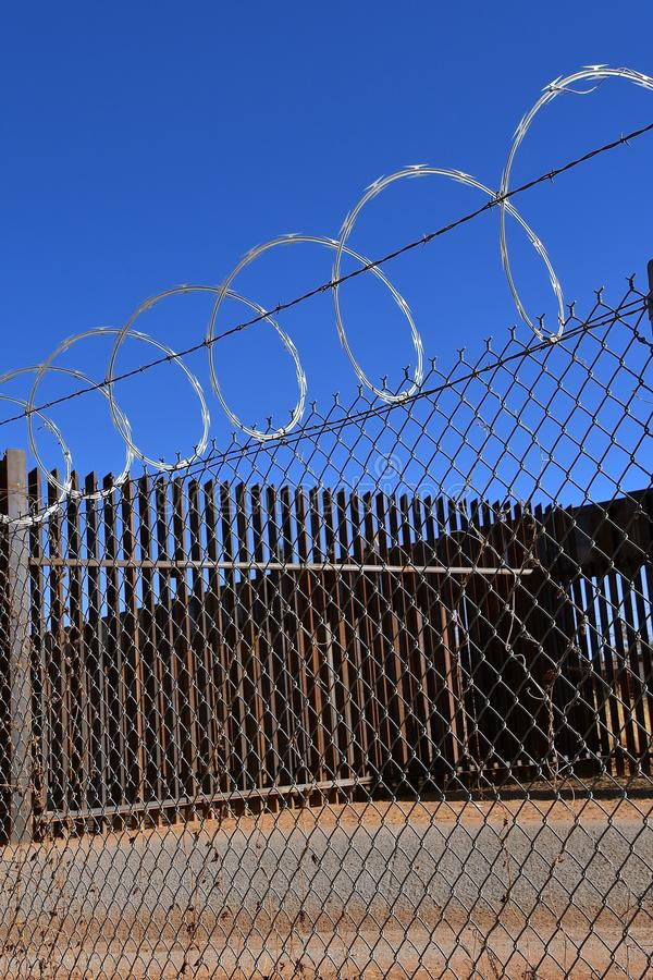 Concertina Wire On Top Of Barrier Fences Stock Photo - Image of ...