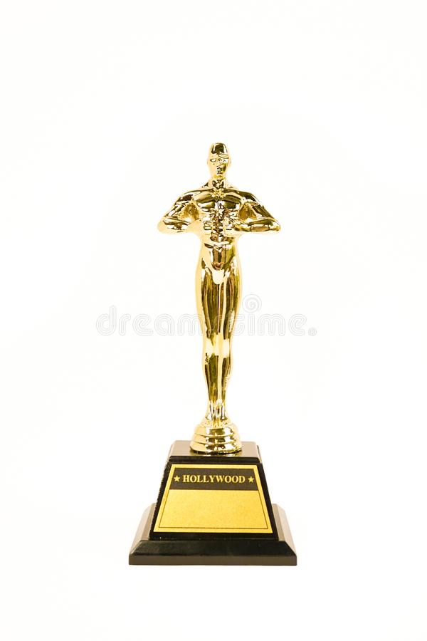 Concessão ou troféu dourado de Oscars isolada em um fundo branco SU imagens de stock royalty free
