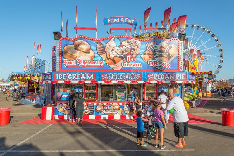 Concession Stand at Arizona State Fair. Fairgoers at the Arizona State Fair in Phoenix line up at a concession stand to purchase ice cream and other sweet snacks royalty free stock photos