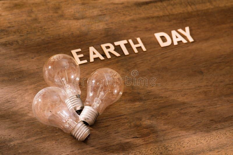 Concetto amichevole di giorno di terra di Eco Energia di risparmio fotografia stock