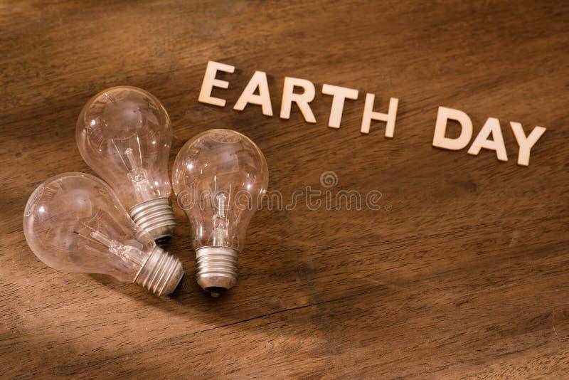 Concetto amichevole di giorno di terra di Eco Energia di risparmio immagini stock libere da diritti