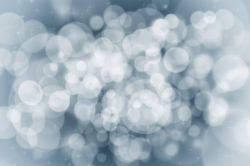 Concetto blu del fondo di Natale con i fiocchi di neve e le scintille fotografie stock