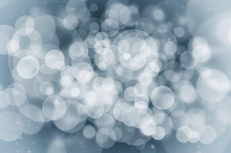 Concetto blu del fondo di Natale con i fiocchi di neve e le scintille immagine stock