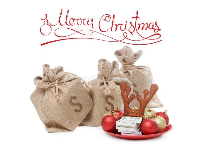 Concetto dei regali di Natale Soldi, pila di valuta usd del dollaro, su fondo bianco immagine stock libera da diritti