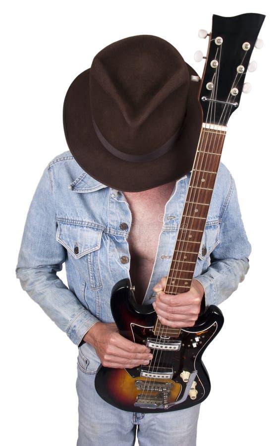 Concetto del giocatore di chitarra del musicista della stella di rock-and-roll fotografia stock libera da diritti