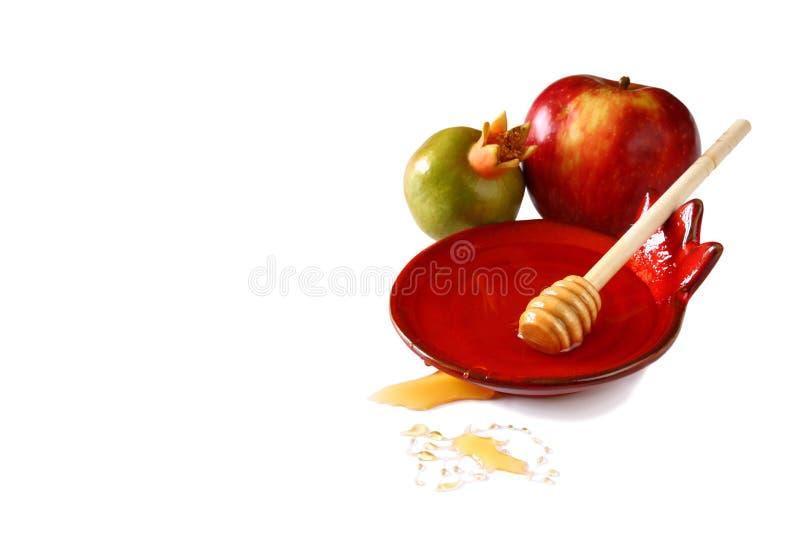 Concetto del hashanah di Rosh (festa del jewesh) - miele, mela e melograno isolati su bianco simboli tradizionali di festa immagine stock libera da diritti