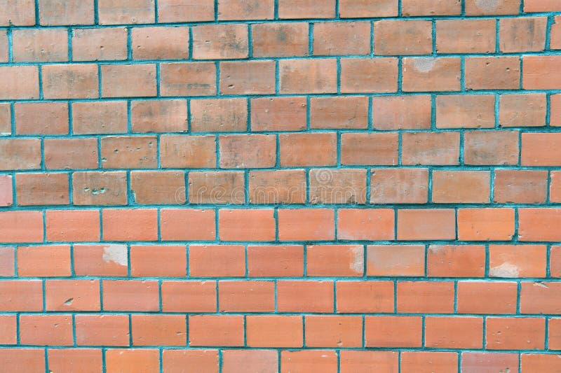 Concetto del materiale da costruzione Muro di mattoni urbano del magazzino di lerciume vuoto industriale del fondo Superficie sul fotografia stock