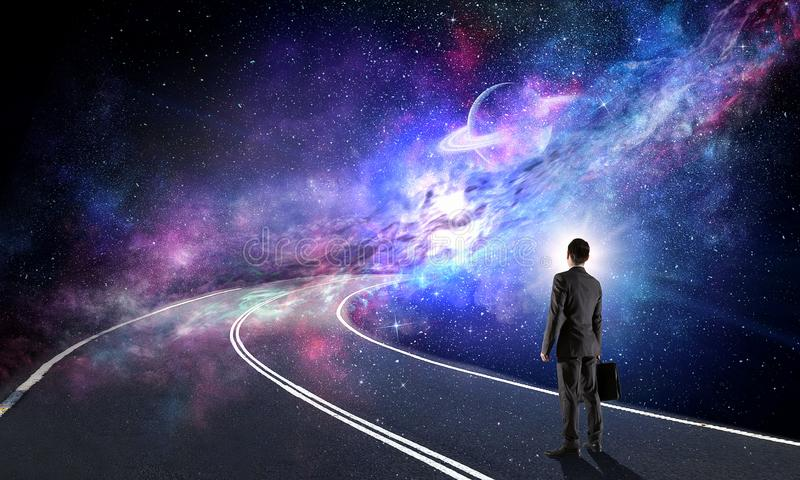Concetto dell'universo e dell'uomo d'affari fotografie stock