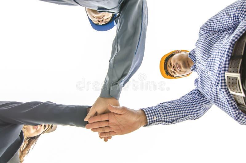 Concetto di affari, della costruzione, di associazione, di gesto e della gente, fotografia stock