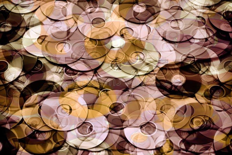 Concetto di archiviazione di dati, oro stratificato ed astrazione marrone dischi di archiviazione di dati del CD e di DVD immagine stock