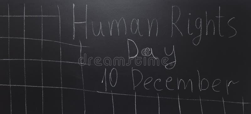 Concetto di diritti umani: Il testo: Giorno di diritti umani scritto sulla lavagna immagini stock