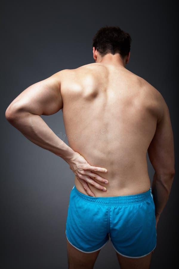 Concetto di dolore alla schiena immagine stock