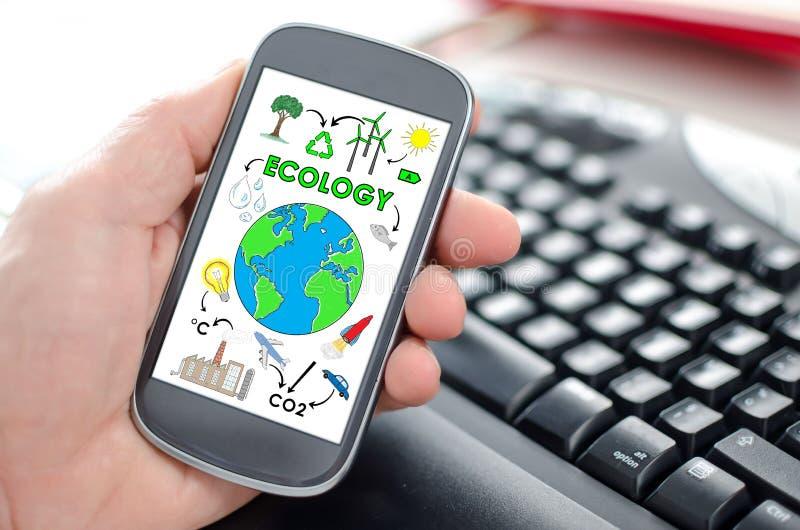 Concetto di ecologia su uno smartphone immagine stock libera da diritti