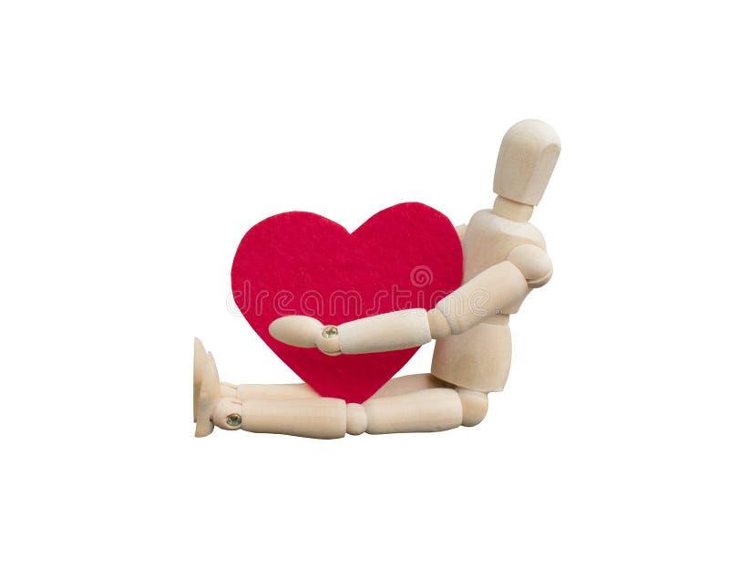 Concetto di giorno del ` s del biglietto di S Abbraccio fittizio di legno una forma del cuore che ha fatto da tessuto ritenuto ac immagine stock libera da diritti